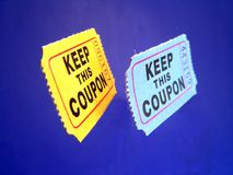 Admission Tickets. Two admission tickets or coupons frying in the air royalty free stock photography