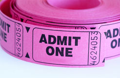 Admit. Close up of pink admit one tickets royalty free stock photo