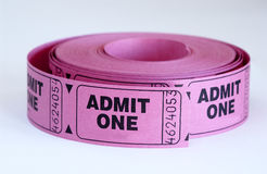 Admit. Close up of pink admit one tickets stock photos