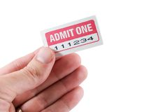 Admit One. Hand holding an admit one ticket isolated on white royalty free stock photos
