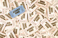 Admit one cinema ticket background with one unique blue ticket. Admit one cinema tickets background with one unique blue ticket Royalty Free Stock Photography