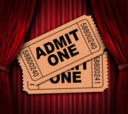 Admit one movie tickets on red drapes. Admit one pass multi movie tickets on theatrical red velvet curtains and cinema drapes Royalty Free Stock Photo