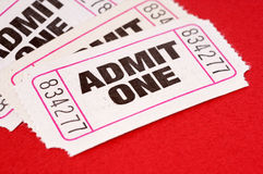 Admit one tickets, untidy pile, red background Stock Photography