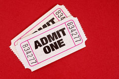 Admit one tickets, white pair on red background Stock Photo
