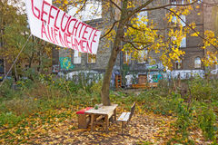 Admit Refugees. Berlin, Germany - October 26, 2013: Banner inscribed with Admit Refugees (Gefluechtete aufnehmen) - in a less wealthier neighborhood of Berlin Royalty Free Stock Photography
