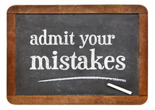 Admit your mistakes - blackboard. Admit your mistakes - advice on a vintage slate blackboard stock photo