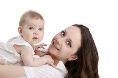 Ładna potomstwo matka i jej uroczy dziecko Zdjęcie Stock