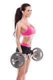 Ładna seksowna kobieta robi treningowi z dużym dumbbell, retuszującym Zdjęcia Royalty Free