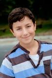 Ładny preteen chłopiec ono uśmiecha się Zdjęcie Stock