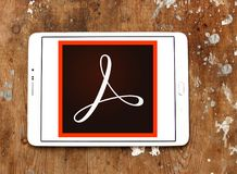 Adobe Acrobat logo. Logo of Adobe Acrobat on samsung tablet. Adobe Acrobat is a family of application software and Web services developed by Adobe Systems to Stock Photography