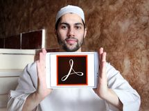 Adobe Acrobat logo. Logo of Adobe Acrobat on samsung tablet holded by arab muslim man. Adobe Acrobat is a family of application software and Web services Royalty Free Stock Photography