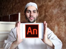 Adobe Animate software logo. Logo of Adobe Animate software on samsung tablet holded by arab muslim man. Adobe Animate is a multimedia authoring and computer royalty free stock photos
