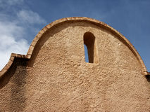 Adobe arch. Detail of church at Mission San Xavier del Bac in Tucson, AZ Royalty Free Stock Image