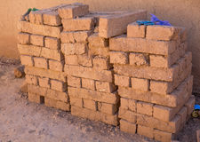 Adobe bricks. Handmade red and brown adobe bricks stacked and ready Royalty Free Stock Image