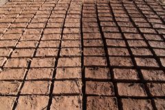 Adobe bricks drying in the sun for construction in Ouarzazate forming a pattern.  stock photos