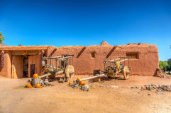 Adobe building with Ox carts. royalty free stock image