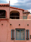 Adobe Casa. A cracked pink adobe house with a blue sky Stock Photography