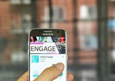 Adobe contrata em um telefone celular Fotografia de Stock Royalty Free