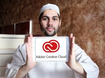 Adobe Creative Cloud logo. Logo of Adobe Creative Cloud on samsung tablet holded by arab muslim man. Adobe Creative Cloud is a set of applications and services royalty free stock photo