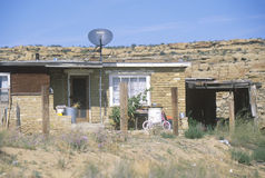 Adobe home with satellite dish Stock Image