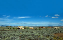 Adobe homes among sagebrush Stock Photo