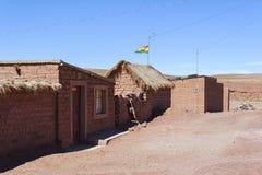 Adobe house in Cerrillos village on Bolivian Altiplano near Eduardo Avaroa Andean Fauna National Reserve with blue sky, Bolivia. South America Stock Photo