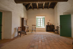Adobe house. Early 19th century adobe house. A room is illuminated by window light royalty free stock image