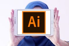 Adobe Illustrator logo. Logo of Adobe Illustrator on samsung tablet holded by arab muslim woman. Adobe Illustrator is a vector graphics editor developed and Royalty Free Stock Images