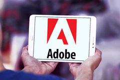 Adobe logo. Logo of adobe company on samsung tablet in hands royalty free stock photo