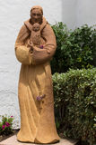 Adobe Padre Statue Stock Images