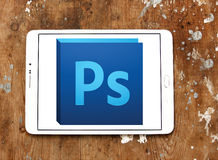 Adobe photoshop logo. Logo of adobe photoshop program on samsung tablet on wooden background Royalty Free Stock Images
