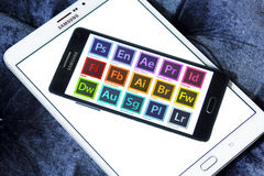 Adobe programs logos and icons. Icons and logos of adobe programs on samsung mobile phone a5. programs like photoshop, encore, after effects, premiere pro Stock Photo