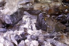 Adobe rgb image of purple crystal ore. The composition of amethyst is silica. hardness is 7.  specific gravity is 2.65. refractive index is 1.54-1.55. it is Stock Images