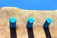 Adobe Roofline. Roofline of adobe home in Taos, New Mexico, shows turquoise painted timbers Royalty Free Stock Photography