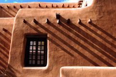 Adobe Shadows. A traditional adobe building with caste shadows created by structural vigas. Located in Santa Fe, New Mexico Royalty Free Stock Images