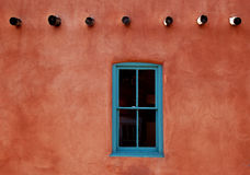 Adobe with Turquoise Window royalty free stock photos