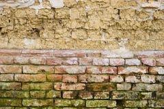Adobe und Wand des roten Backsteins Stockbild