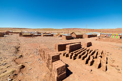 Adobe village on the desertic Andean highlands in Bolivia Stock Photography