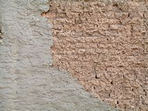 Adobe wall. Rough beige adobe stucco exterior wall Royalty Free Stock Image