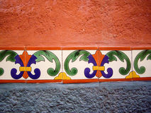 Adobe wall with color tile Stock Image