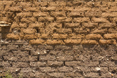 Adobe wall h. Old and dirty adobe wall Stock Images