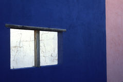 Adobe Wall and Window. Window in adobe architecture that has traditional colorfully painted walls Royalty Free Stock Photo