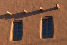 Adobe wall with windows. At dusk in Santa Fe Royalty Free Stock Images