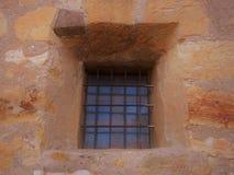 Adobe Window. A barred window in a adobe wall.  Mission, Carmel, California Stock Photos