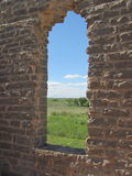 Adobe window in ruined building. Looking through a window of an abandoned, ruined adobe building in Texas hill country Royalty Free Stock Photography