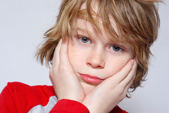 Adolescence. A boy looks confused and unsure Stock Images
