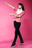 Adolescence. Young Funny Asian Woman Gesturing with her Hands. Fancy Woman Gesturing with her Hands over pink Royalty Free Stock Photo