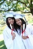 Adolescencias bonitas en la graduación Imágenes de archivo libres de regalías