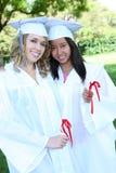 Adolescencias bonitas en la graduación Foto de archivo