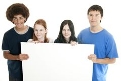 Adolescencias con la muestra en blanco Imágenes de archivo libres de regalías